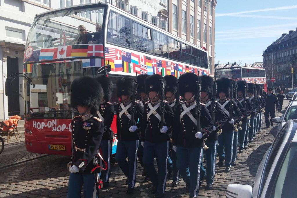 Royal Guards marching past a Copenhagen Bus Tour