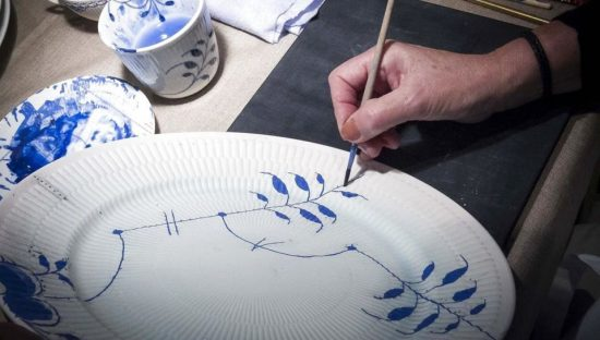 Royal Copenhagen plate being hand painted